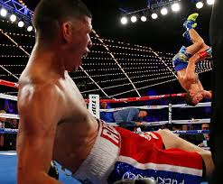 "Vasyl Lomachenko doing a backflip after he knocks out Roman ""Rocky"" Martinez on June 11, 2016 in the Madison Square Garden Arena in New York to win the WBO World Super Flyweight title."