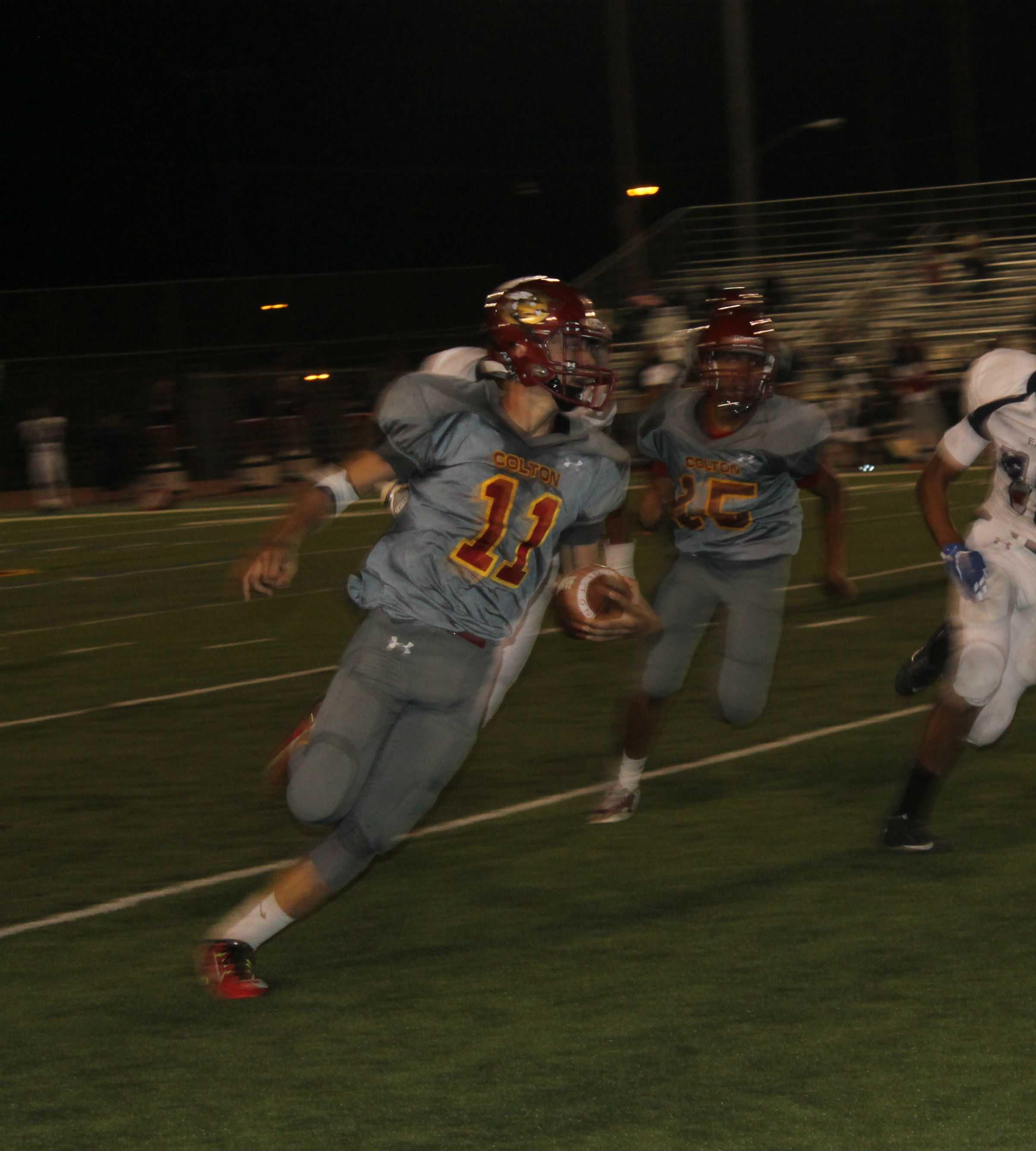 Sophomore running back Brennan Ramos, No. 11, turns the corner against La Sierra.