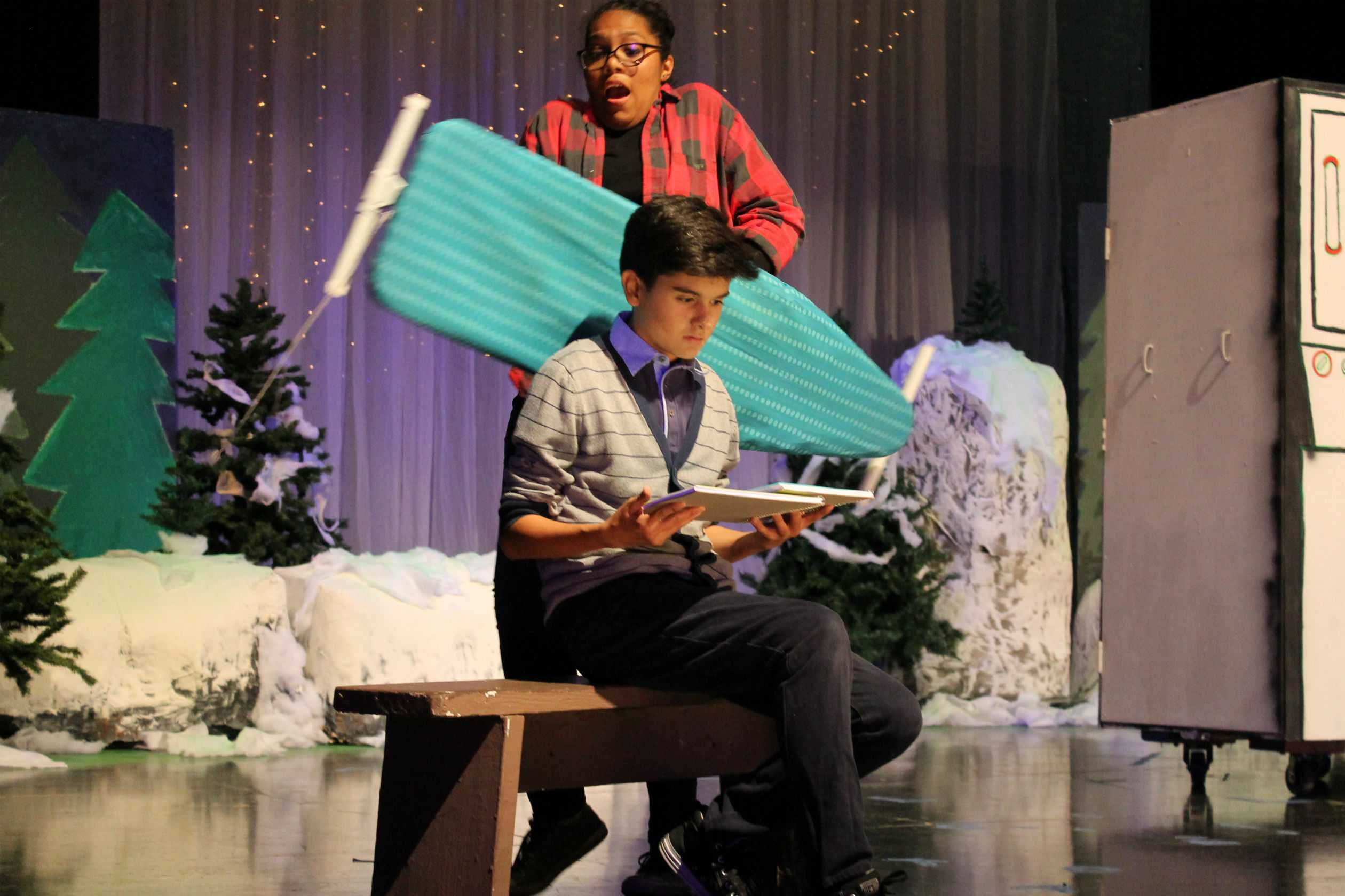 Senior Lani Willliams gets all close and personal with Junior Timothy Valdez in a scene from the rollicking  comedy