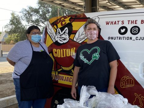 """Marleen Perez (left) and Kelly Felix (right) work for Nutrition Services. Ms. Felix: """"It makes my heart happy to help the community."""""""