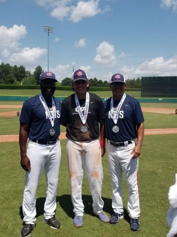 Azael Hernandez (center) celebrates his silver medal victory at the NTIS tournament this past week in North Carolina.