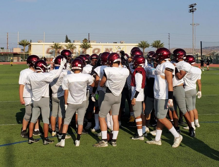The Yellowjackets huddle up in preparation for the 2021 season.