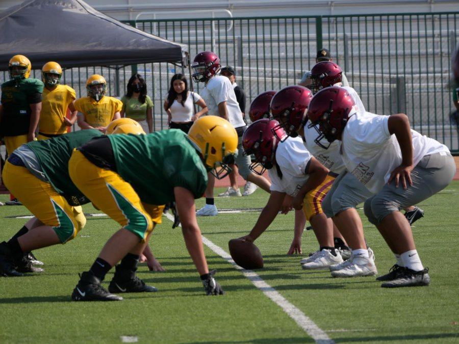 The Yellowjacket offense lines up against the Coachella Valley High defense in this pre-season warm-up.