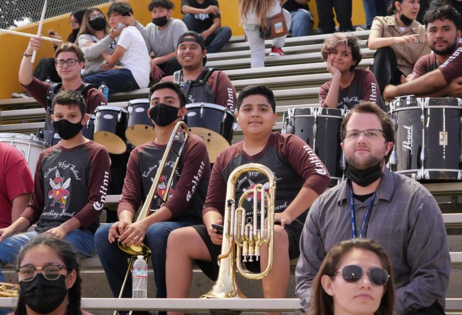 Mr. Kenneth Taber (left), takes a break with his band students between performances at last Fridays football game vs. Alta Loma.