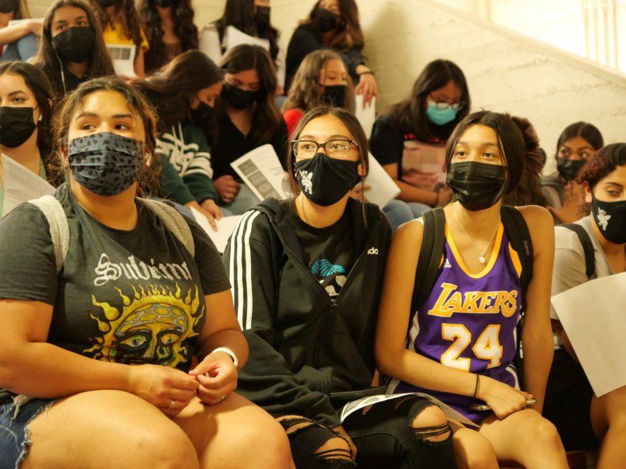 Juniors Larissa Lopez, Arianna Hernandez, and Natalie Lopez listen intently to the informational Powderpuff session.