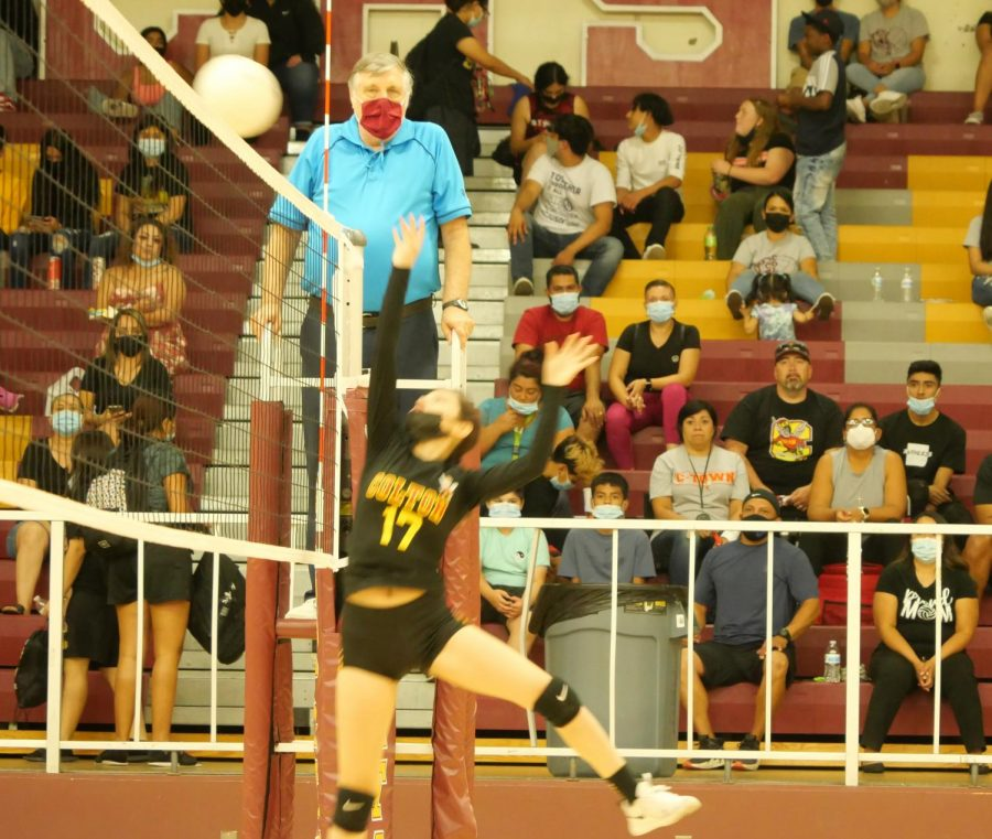 Opposite hitter Marissa Herrera saves the ball to keep the volley alive.