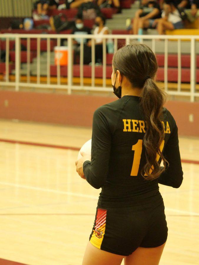 Marissa Herrera prepares for a big serve in the third game.