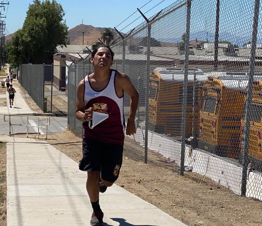Senior Adrian Negrete takes that final hill up 3rd Street before the final stretch of his three-mile run.