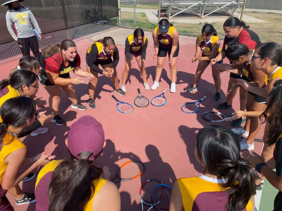 The girls tennis team gets themselves psyched up with this pre-match ritual.