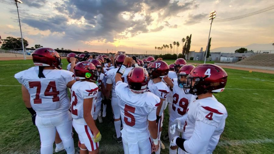 The Yellowjackets come together before the game to get their focus right. They went on to win, 35-6.