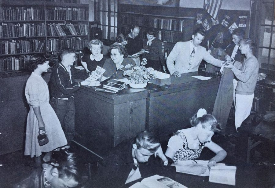 The CHS library was built in 1957. Librarian Minnie Bishop, pictured here helping students, loved the new facilities.