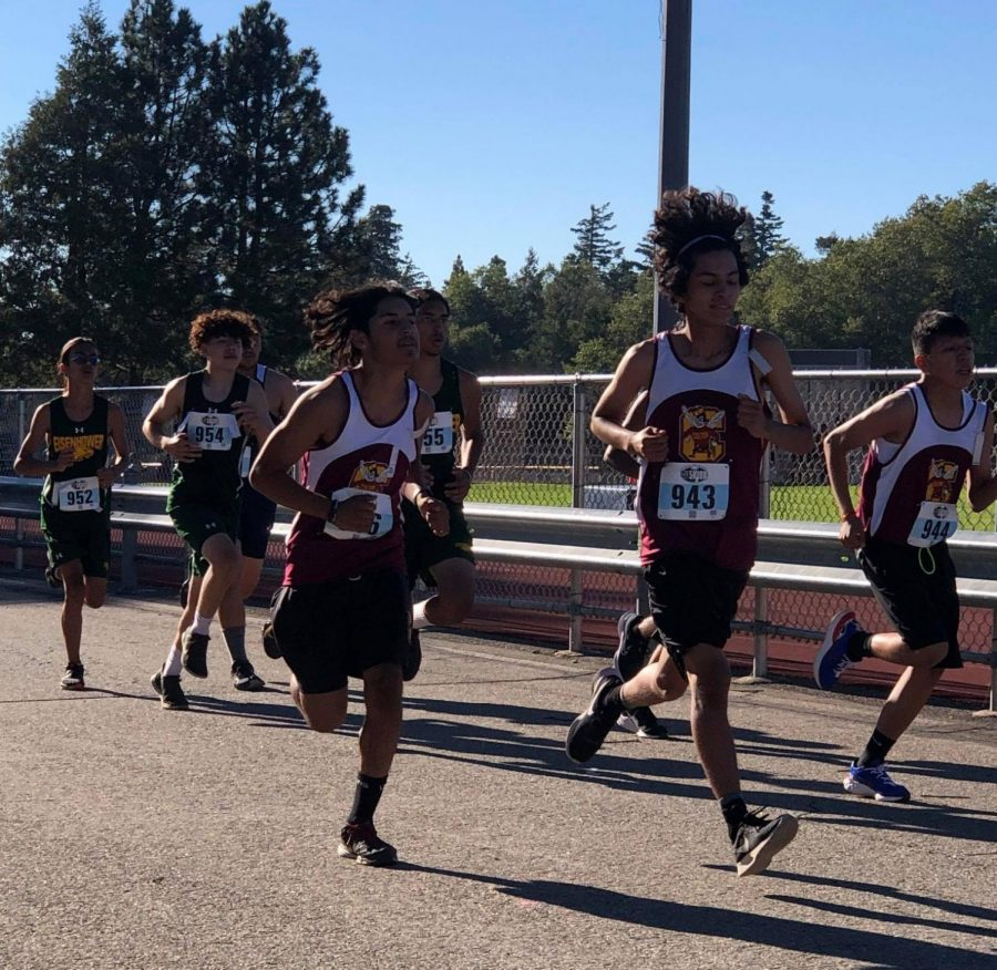 The Boys Varsity squad, led by sophomore Juan Barron, hits the course at the Rim of the World Cross-Country meet.