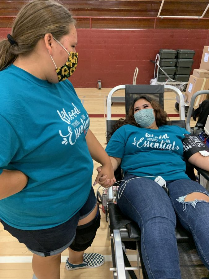 Larissa+Lopez+%28Grade+11%29%2C+HEAL+student+and+2nd+blood+donor+of+the+day%2C+laughs+as+friend+Haley+Arenas+supports+her+while+getting+blood+drawn.