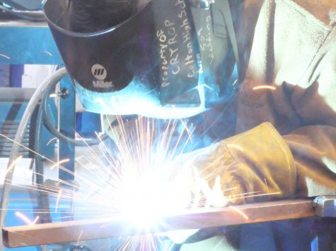 Israel Galindo (grade 11) works on a project in the metal shop after school in the Welding Club.