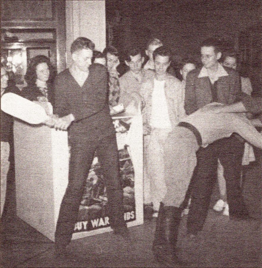 Colton High students spank Hitler as a fundraising stunt to boost bond sales in April 1943.