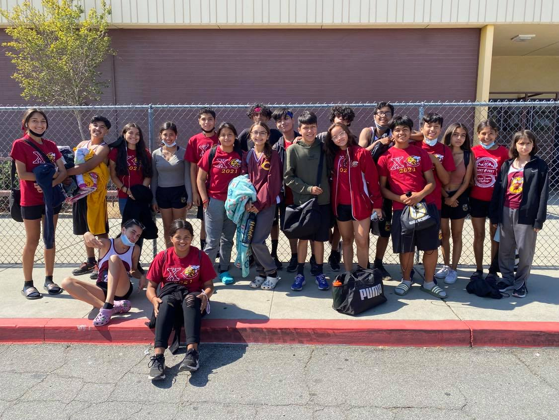 The Cross-Country crew prepares to board the bus before their Saturday morning meet at Glen Helens Inland Empire Challenge.