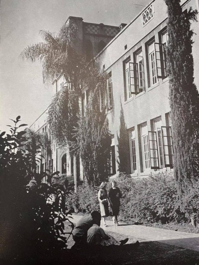 Students take a stroll outside the picaresque admin building in 1953. It would be burned down in a mysterious event in 1966.