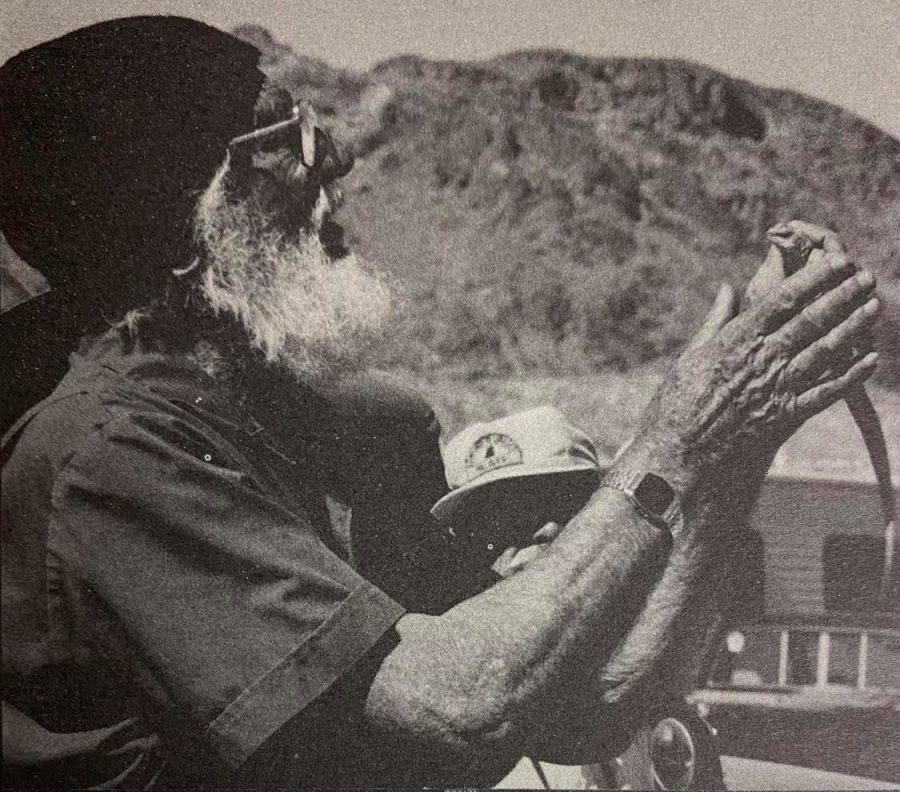 Oscar Clarke, a renowned botanist and naturalist, is one of Colton Highs most distinguished alumni. Here he is in 1995, teaching in the field about the habits of desert iguana.