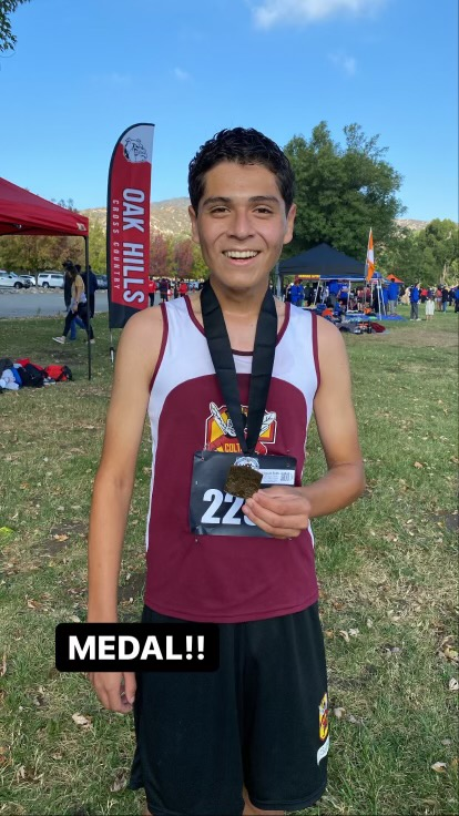 Vincent Solis shows off his medal at the Inland Empire Challenge.