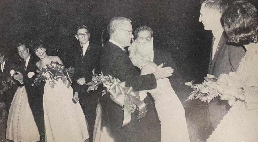 Sharon Yarnell, whose formal strap broke halfway through the Homecoming game, hugs Principal Charles Jordan after being announced the 1964 CHS Homecoming Queen.