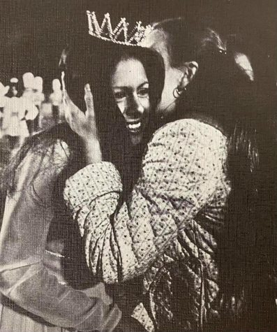 Homecoming Queen Belinda Felix receives a hearty congratulations from her friend, Denise Bourns.