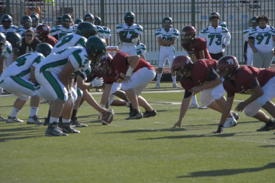 JV football lines up against Eisenhower High School on Oct. 14. Their game against Summit High, scheduled for Oct. 21, was canceled.