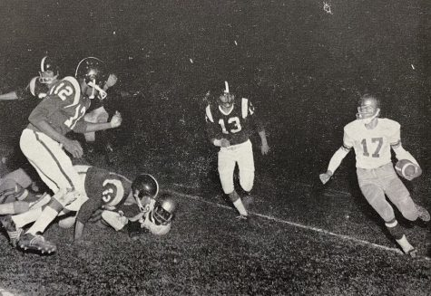 Quarterback Mike Rothwell turns the corner for a big gain in this photo from the 1960 Yellowjacket varsity football squad.
