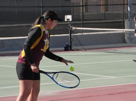Emily Ramirez prepares for a big serve during their set against Kaisers number one team. She and her partner, Juliette Echauregui took all three of their sets against Kaiser.