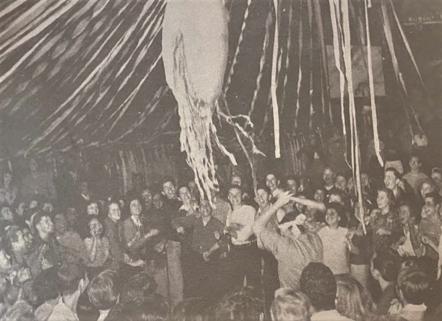 The Pan American Dance was a popular event hosted by the Mexican Youth Club, which was started in 1940. This photo shows students striking a piñata at the 1947 dance in the MacIntosh Gym.